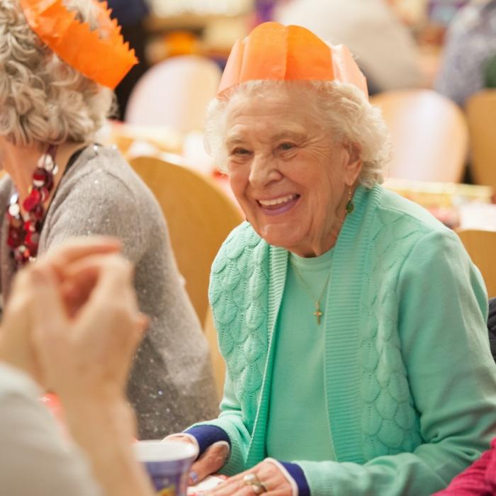 Older lady enjoying a community business event